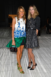 Anna dello Russo chose a pair of lime-green satin sandals to team with her mini dress.
