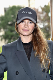 Miroslava Duma contrasted her business-chic outfit with a casual Google cap when she attended the Giambattista Valli fashion show.