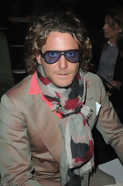 Lapo Elkann attended the Giambattista Valli fashion show wearing a colorful ensemble and a pair of oval sunglasses.