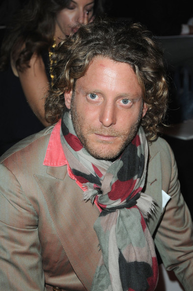 Lapo Elkann wore a mussed-up curly hairstyle during the Giambattista Valli fashion show.