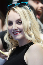 Evanna Lynch attended the Giffoni Film Fest wearing loose, long waves.