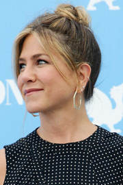 Jennifer Aniston paired her 'do with gold hoop earrings by Jennifer Meyer.