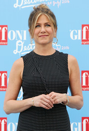 On the other wrist, Jennifer Aniston wore a delicate open-ended diamond bracelet.
