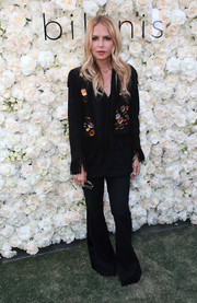 Rachel Zoe was hippie-chic in a fringed, bell-bottom pantsuit at the Gigi C Bikinis pop-up launch event.