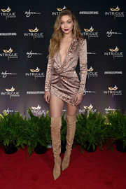 Gigi Hadid put her cleavage and thighs on display in a plunging tux dress by Julien Macdonald during her 21st birthday celebration.