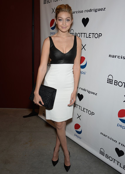 Gigi Hadid Oversized Clutch [clothing,dress,cocktail dress,shoulder,fashion,hairstyle,joint,carpet,fashion model,footwear,gigi hadid,gallery,new york city,sikkema jenkins and co,narciso rodriguez bottletop collection pepsi u.s. launch]