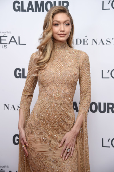Gigi Hadid Statement Ring [hair,dress,clothing,fashion model,hairstyle,shoulder,cocktail dress,neck,fashion,blond,arrivals,women of the year awards,gigi hadid,brooklyn,new york,kings theatre,glamour,glamour celebrates 2017 women of the year awards]