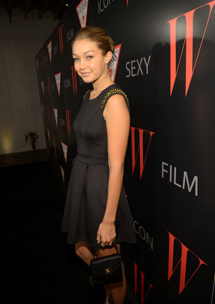 Gigi Hadid Satin Purse [guess celebrate 30 years of fashion and film and the next generation,years of fashion and film and the next generation of style icons,little black dress,premiere,dress,fashion,cocktail dress,shoulder,event,fashion model,flooring,carpet,red carpet,gigi hadid,style icons,laurel hardware,west hollywood,california,w magazine,guess]