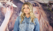 Gigi Hadid wore sweet center-parted waves during a Guess event at the Myer Macquarie Centre.