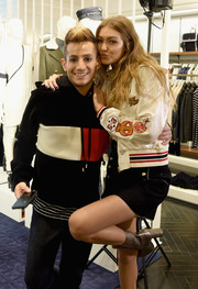 Gigi Hadid visited Amazon's  'Style Code Live' looking sporty in a Tommy x Gigi varsity jacket.
