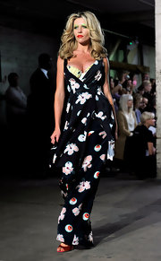 Abbey Clancy modeled a dress with a zany print during the Giles fashion show.