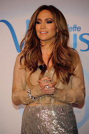 Jennifer Lopez paired her sequined skirt and nude top with a pyramid bangle bracelet.