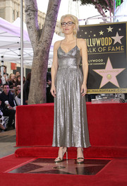 Gillian Anderson amped up the shimmer with a pair of metallic sandals by Jimmy Choo.