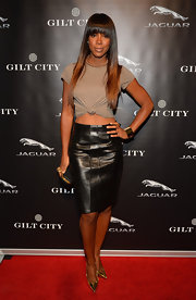 Kelly Rowland spiced up her style with a leather pencil skirt.