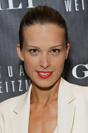 Petra Nemcova pulled her hair back in a sleek ponytail for the 5050 boot anniversary.