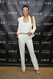 Petra Nemcova looked impeccable in a sleek white pantsuit during the 5050 boot anniversary.