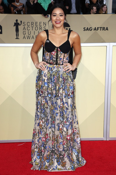 Gina Rodriguez Corset Dress [flooring,carpet,fashion model,hairstyle,fashion,dress,red carpet,girl,gown,long hair,arrivals,gina rodriguez,screen actors guild awards,los angeles,california,the shrine auditorium]