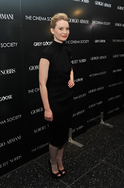 Mia Masikowska finished off her simple black turtleneck dress with a pair of matching peep-toes.