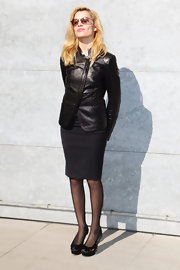 Micaela Ramazzotti mixed her up classic LBD with a leather asymmetric jacket.