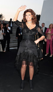 Sophia Loren chose a ruffled asymmetrical-hemmed LBD for her look at the 'One Night Only' event in Rome.
