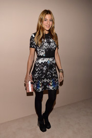 Dani Stahl looked modern and chic in a zigzag-print mini dress during the Giorgio Armani SuperPier show.