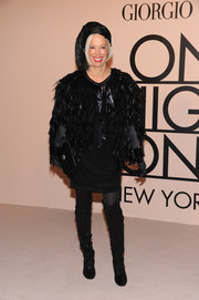 Linda Fargo looked original in a black feather cape and a matching headdress during the Giorgio Armani SuperPier show.