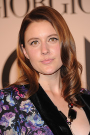 Greta Gerwig was all dolled up with this retro-glam wavy 'do at the Giorgio Armani SuperPier show.