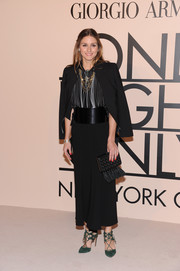 Olivia Palermo paid homage to Armani during his SuperPier show by wearing this black skirt suit by the designer.