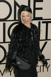 Linda Fargo went all black at the Armani SuperPier show with this satin clutch, feather cape, and LBD combo.