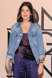Leandra Medine topped off her look in casual style with a denim jacket when she attended the Giorgio Armani SuperPier show.