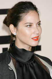 Olivia Munn pulled her hair back in a messy-glam bun for the Giorgio Armani SuperPier show.