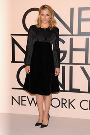 Dianna Agron looked conservative yet classy in this Armani LBD at the Giorgio Armani SuperPier show.