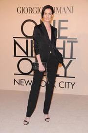 Erin O'Connor went for simple sophistication with this black pantsuit at the Giorgio Armani SuperPier show.