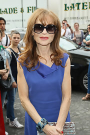Isabelle Huppert wore butterfly sunglasses for a chic finish to her look.