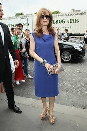 Isabelle Huppert kept it low-key at the Armani Prive fashion show with a blue cowl-neck dress.