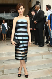 Dolores Chaplin looked avant-garde in this striped iridescent dress with a moon neckline.