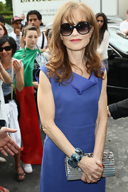 Isabelle Huppert's textured printed clutch added a graphic pop to her ensemble at the Armani Prive fashion show.