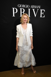 Naomi Watts tied her look together with a pair of nude peep-toes.