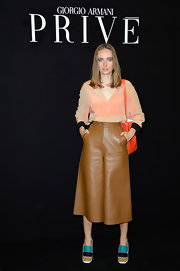 Olga played with textures when she paired this sheer nude blouse with leather culottes.