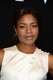 Naomie pulled back her lovely locks into a half updo for a classically elegant look at the Giorgio Armani Prive front row.
