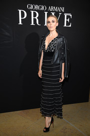 Tallia Storm attended the Armani Prive fashion show wearing a deep-V black-and-white dress under a leather biker jacket.
