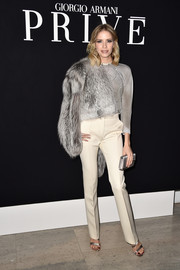 For her bag, Elena Perminova chose an elegant silver satin clutch.