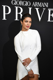 Priyanka Chopra glammed up her plain white frock with a diamond bracelet for the Armani Prive fashion show.