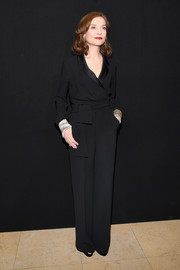 Isabelle Huppert kept it sleek and elegant in a black tux jumpsuit at the Armani Prive fashion show.