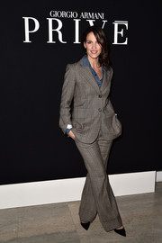 Linda Hardy attended the Giorgio Armani Prive show wearing a patterned gray pantsuit with a denim button-down.