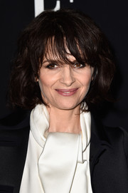 Juliette Binoche wore her hair in a curled-out bob with wispy bangs during the Giorgio Armani Prive show.