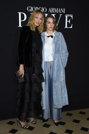 Maya Hawke matched her coat with a pair of blue wide-leg pants.
