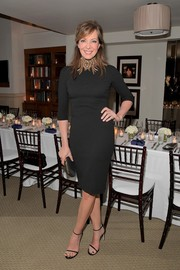 Black Stuart Weitzman sandals completed Allison Janney's sleek look.