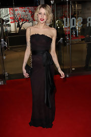 Peaches Geldof wore a strapless lace evening dress with an oversized sash for the 'Girl With The Dragon Tattoo' red carpet.