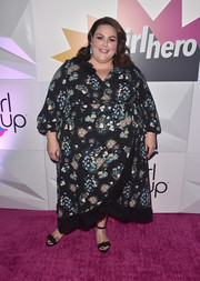 Chrissy Metz attended the #girlhero Awards luncheon wearing a stylish floral wrap dress by LOFT.